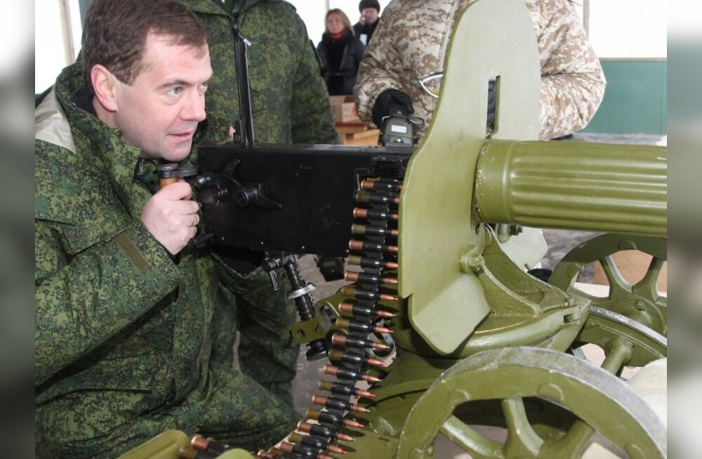 Russian President Dmitry Medvedev seen at the exhibition of World War II weapons while visiting a test  range outside Moscow on Thursday, Jan. 14, 2010. (AP Photo/RIA-Novosti, Mikhail Klimentyev, Presidential Press Service) / SCANPIX Code: 436