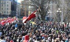 DELFI RIIAS: Leegionäride päeval lehvitati ka Eesti lippe