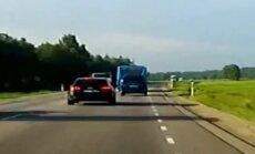 ВИДЕО читателя Delfi: Водитель Audi совершает опасный обгон, грузовик отклонился в последний момент