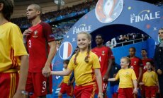 607136815 McDonald's player escorts at UEFA Euro 2016, Saint-Denis, France.