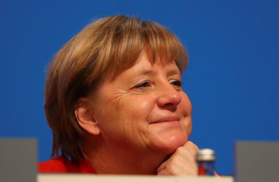 Больше половины германцев - за«большую коалицию» блока Меркель иСДПГ